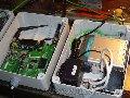 Detalle de dos puntos de acceso, un Linksys WRT54G y un Dlink 900+ dentro de sendas cajas estancas.